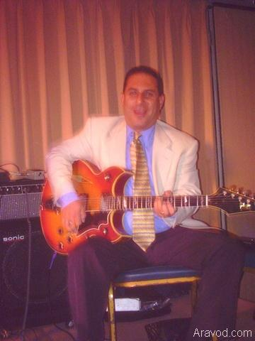 Mal Barsamian playing guitar.jpg
